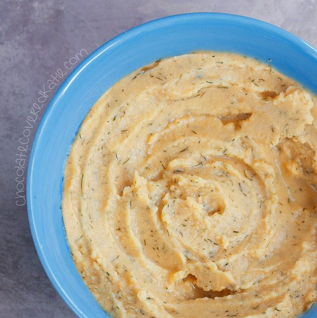 Homemade hummus recipe that tastes surprisingly like Cool Ranch Doritos! Recipe link: https://chocolatecoveredkatie.com/2015/05/28/cool-ranch-hummus/