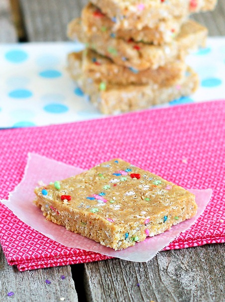 With almost 200 positive reviews of the recipe, these are a reader favorite. Healthy snack bars that really do taste surprisingly like you are eating actual cake batter: http://chocolatecoveredkatie.com/2012/06/26/cake-batter-energy-bars/