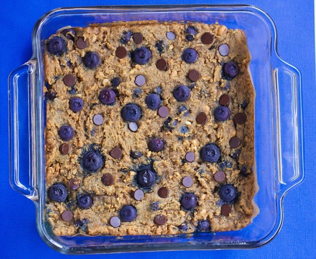 Gooey Chocolate Chip Blueberry Bars - Crazy addictive recipe... like the lovechild of a chocolate chip cookie and a blueberry pie! Recipe link: https://chocolatecoveredkatie.com/2015/08/13/chocolate-chip-blueberry-bars-flourless/