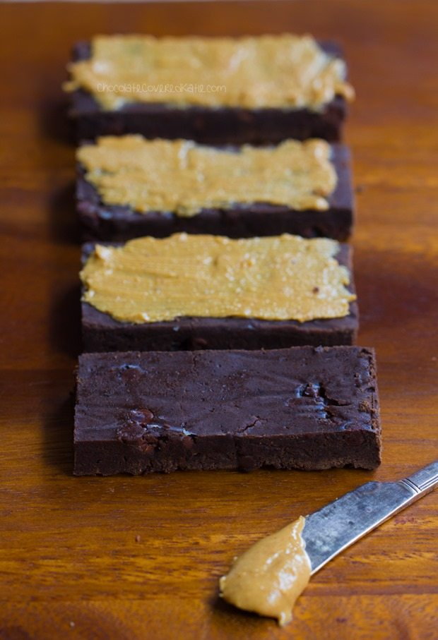 NO flour, NO refined sugar chocolate protein bars - tastes like eating a Reeses Peanut Butter Cup... but GOOD for you!!! - http://chocolatecoveredkatie.com/2016/01/06/homemade-protein-bars-chocolate-peanut-butter-vegan/ @choccoveredkt