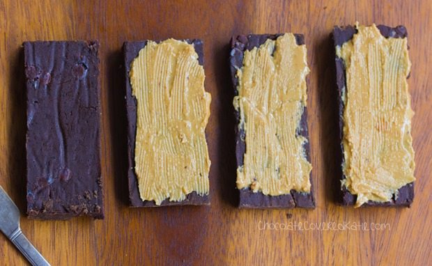 Homemade Protein Bars - Avoid the unhealthy processed ingredients by making your own HEALTHY chocolate protein bars at home - These bars taste like a Reeses peanut butter cup!!! http://chocolatecoveredkatie.com/2016/01/06/homemade-protein-bars-chocolate-peanut-butter-vegan/ @choccoveredkt