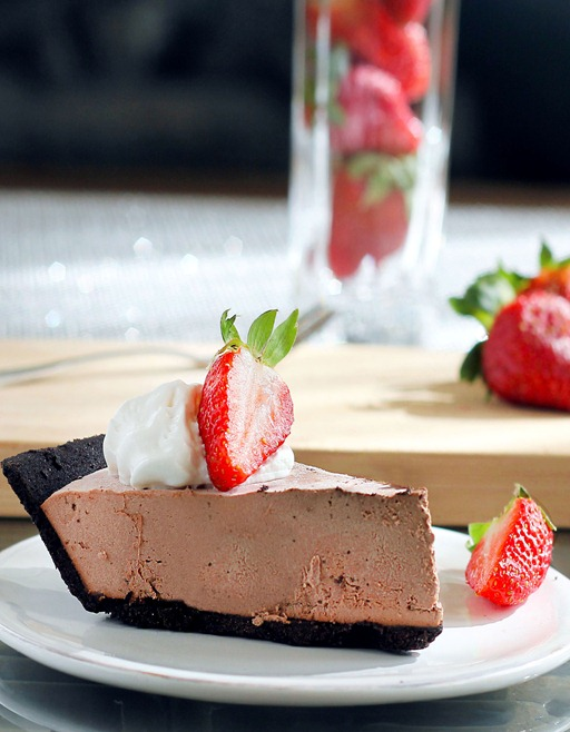 Melt-In-Your-Mouth Chocolate Truffle Pie: no sugar, no flour, no baking required. Tastes so sinfully rich, but it is secretly GOOD for you!  http://chocolatecoveredkatie.com/2012/02/16/chocolate-strawberry-truffle-pie/
