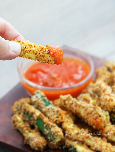 """CRISPY HEALTHY BAKED ZUCCHINI FRIES - With a crispy """"junk food"""" taste, you could technically eat the ENTIRE recipe for under 200 calories! http://chocolatecoveredkatie.com/2013/05/28/crispy-healthy-baked-zucchini-fries/"""