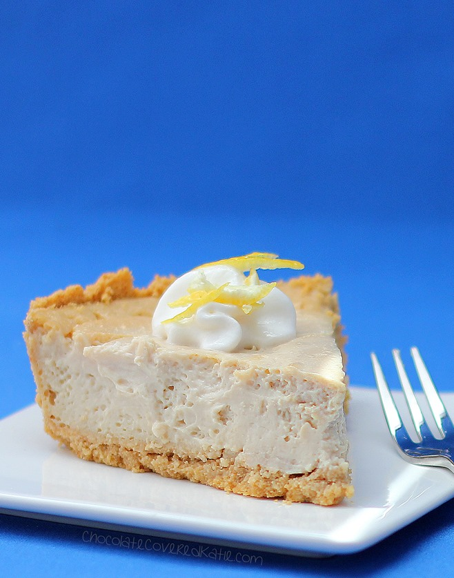 LEMON CLOUD CHEESECAKE - Secretly low-fat, gluten-free, vegan, and nut-free! The texture is amazing! Recipe link: https://chocolatecoveredkatie.com/2015/05/26/lemon-cloud-cheesecake/
