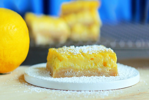 """Soft homemade lemon squares from @choccoveredkt that have been described by readers as being """"the best lemon bar recipe of all time... healthy or not!"""" Full recipe here: http://chocolatecoveredkatie.com/2012/05/07/healthy-lemon-squares/"""