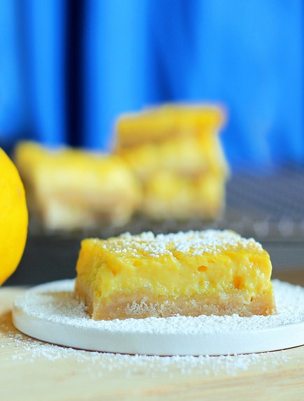 """Soft homemade lemon bars from @choccoveredkt that have been described by readers as being """"the best lemon bar recipe of all time... healthy or not!"""" Full recipe here: http://chocolatecoveredkatie.com/2012/05/07/healthy-lemon-squares/"""