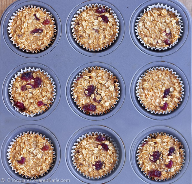 """Featured by Fitness Magazine - customizable """"breakfast"""" oatmeal cupcakes from @choccoveredkt, Great on-the-go fuel on rushed mornings + Can be frozen for later. Full recipe: http://chocolatecoveredkatie.com/2015/01/08/go-breakfast-oatmeal-trail-mix-cupcakes/"""