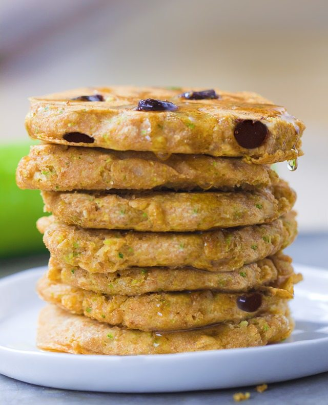A giant stack of extra fluffy zucchini pancakes, stuffed with melty gooey chocolate chips - These disappear so quickly whenever I make them: http://chocolatecoveredkatie.com/2015/08/10/zucchini-pancakes-healthy-vegan/