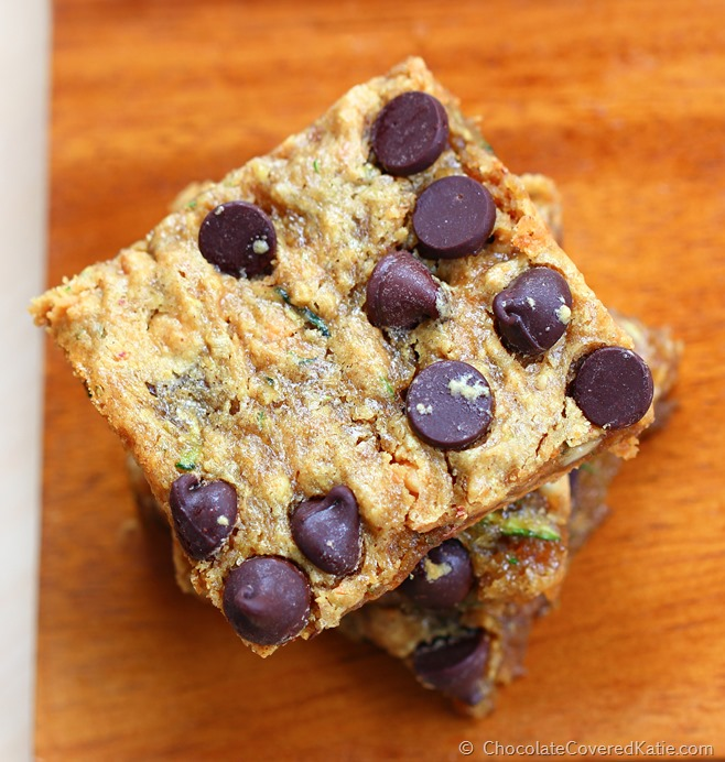 Chocolate Chip Zucchini Bars - Ingredients: 1 cup zucchini, 1/4 cup chocolate chips, 2 tsp vanilla, 1/2 tsp baking soda, 1 tbsp... Full recipe: http://chocolatecoveredkatie.com/2014/11/03/chocolate-chip-zucchini-bars/ @choccoveredkt, & gluten-free options. Secretly healthy chocolate chip zucchini bars. Recipe link: http://chocolatecoveredkatie.com/2014/11/03/chocolate-chip-zucchini-bars/